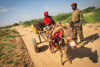 Somalia, donkey cart, woman, soldier, peacekeeping, AMISOM